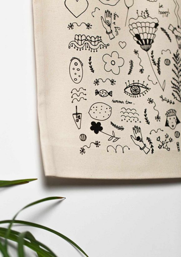 Close-up detail on the back print of the Doodles cotton tote bag.