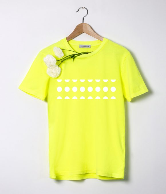 The front of a neon yellow t-shirt with white dots placed in a shape of a rectangle with transparent background.