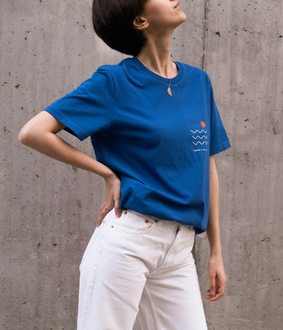 Girl with blue cotton t-shirt and white pants.