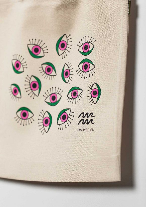 Close-up of colored magenta & green print of the Eyes cotton tote bag.