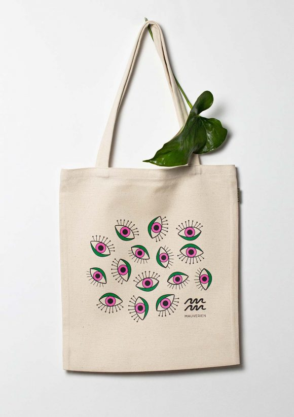 Organic cotton tote bag with eyes printed in green and magenta and Mauverien black logo placed at the bottom right.
