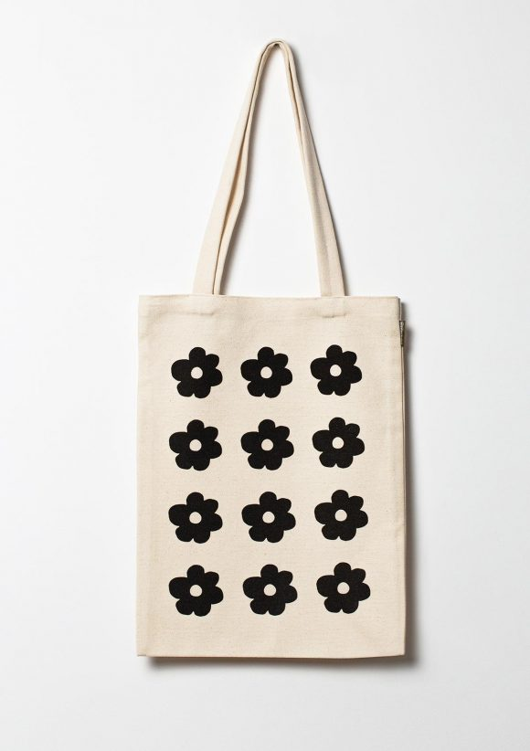Organic cotton tote bag with 12 printed black flowers placed on 3 rows vertically.