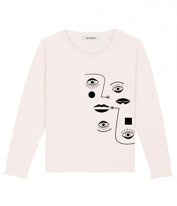 The front of a beige cotton crewneck sweatshirt with black print of eyes and lips and raglan sleeves.