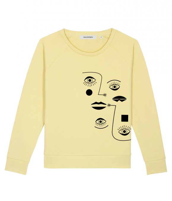 The front of yellow organic cotton sweatshirt with crewneck and black print with minimalist eyes and lips.