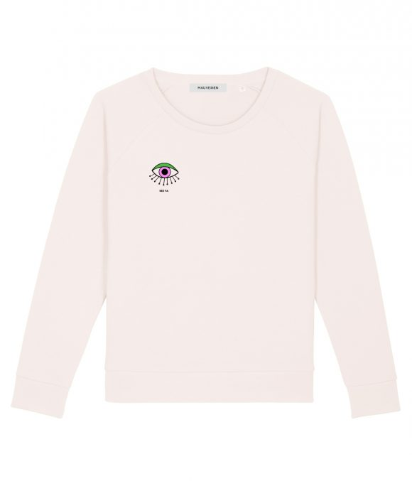 The front of a beige cotton sweatshirt printed with one eye colored in purple and green and placed in the top right.