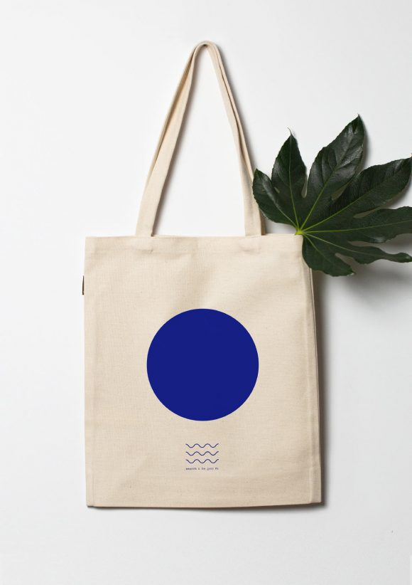 Cotton Tote Bag with blue circle on the center an 3 wavy lines at the bottom.