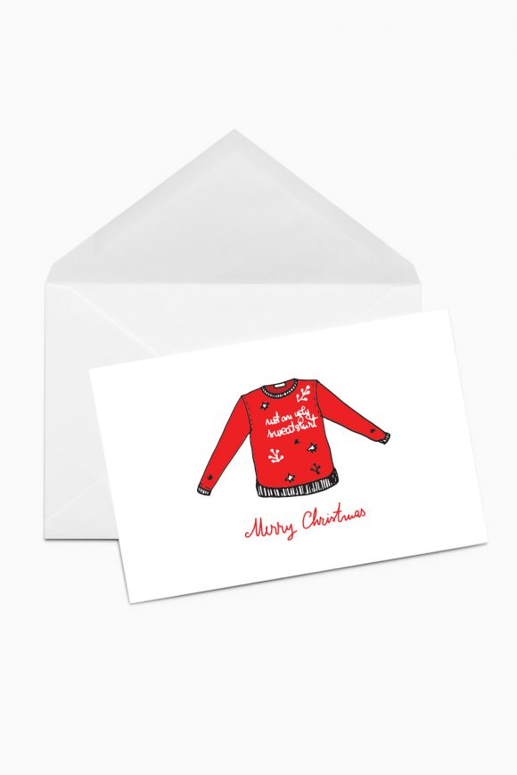 A Christmas card with a red sweatshirt with the message not an ugly sweatshirt.